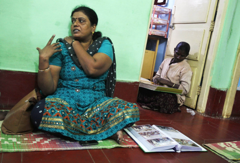 Photo - In this Dec. 4, 2012 photo, Yashoda Puttappa, left, a land rights activist, speaks to The Associated Press at her office in Anekal 40 kilometers (25 miles) from Bangalore in the southern Indian state of Karnataka.  For years, Karnataka's land records were a quagmire of disputed, forged documents maintained by thousands of tyrannical bureaucrats who demanded bribes to do their jobs. In 2002, there were hopes that this was about to change. (AP Photo/Aijaz Rahi)