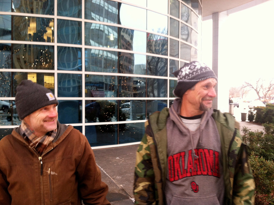 Charles Scott, 43, left, and Jeff Hancock, 48, talk outside the Ronald J. Norick Downtown Library. Photo by Phillip O\'Connor, The Oklahoman Phillip O\'Connor