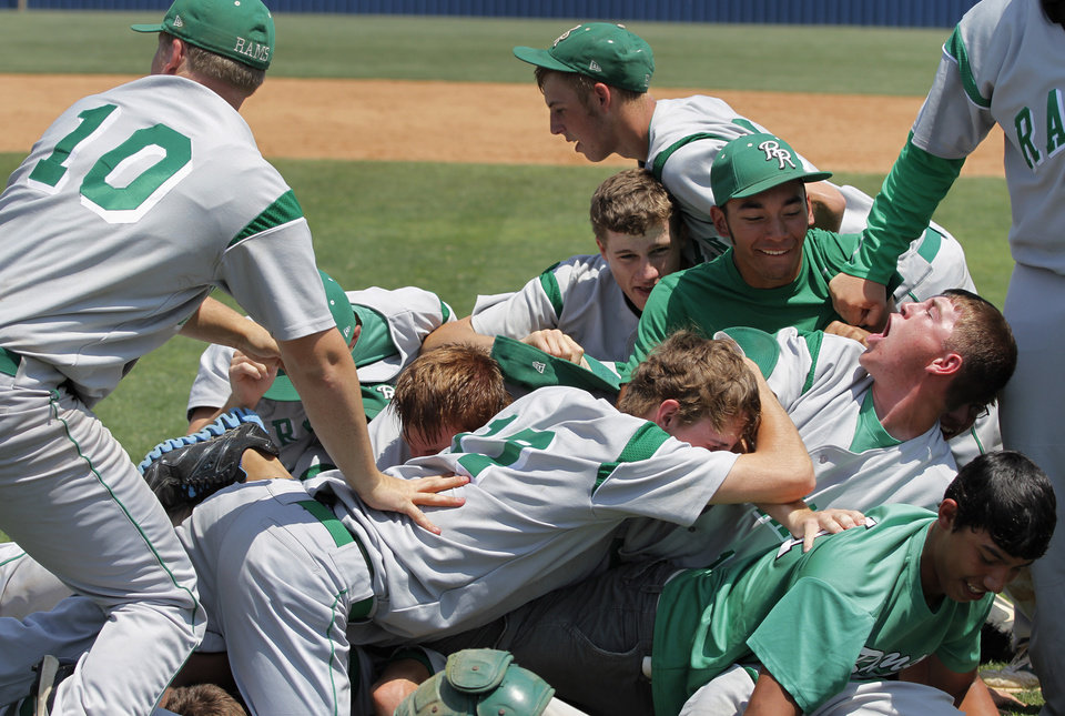 The Rattan Rams dog pile after winning the Class A State Championship game against Amber-Pocasset at Dolese Park in Oklahoma City, Saturday, May 5, 2012.  Photo by Garett Fisbeck, For The Oklahoman