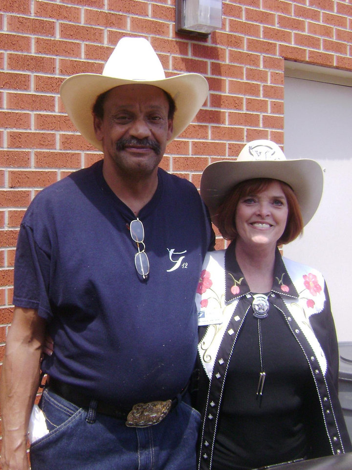 Grace Living Center - Edmond celebrated National Nursing Home Week with a Western-themed cook-out on Friday for residents. Shown here is the home\'s cook Peter Alexander and administrator Lois Baer.