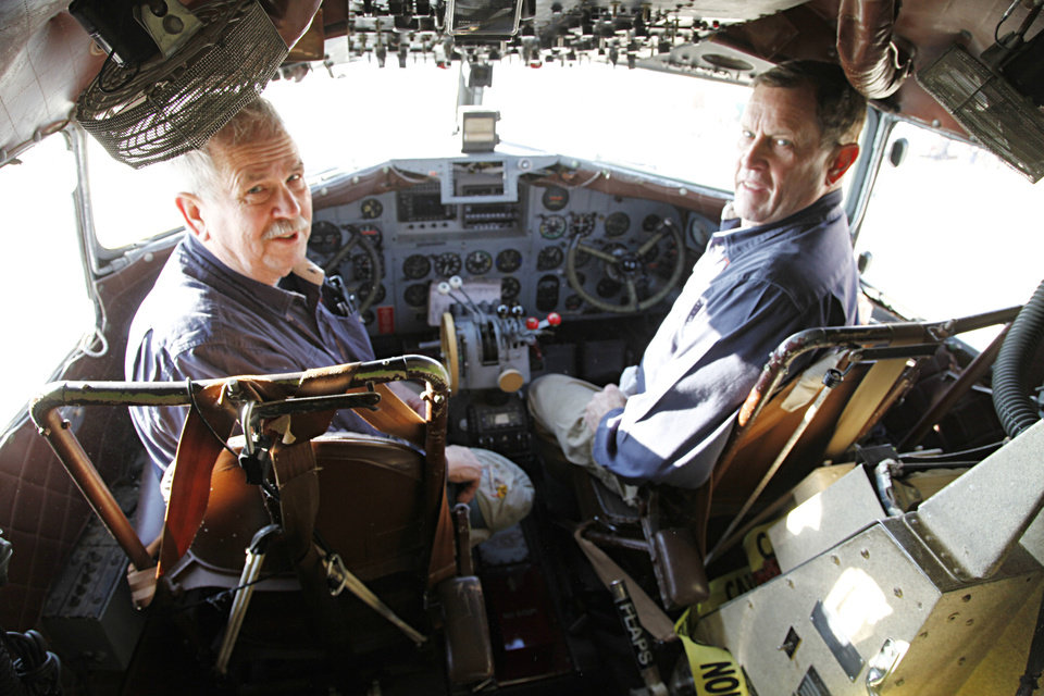 Photo - Pilots Mike Ahern, left, and Dean Alexander sit in the cockpit of a DC-3 as they prepare to take off from the Mike Monroney Center at Will Rogers World Airport to fly the plane to its permanent home in Amarillo, Texas. Photo by Paul Hellstern, The Oklahoman  PAUL HELLSTERN