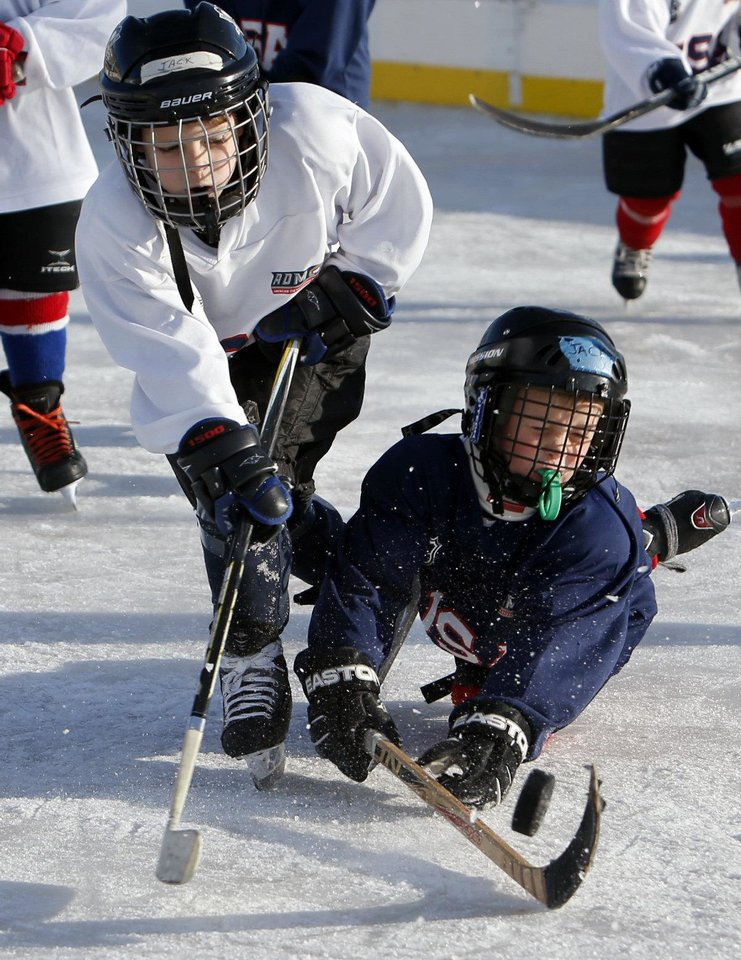 Members of the Oklahoma City Youth Hockey Association's 8 and Under League go for the puck Saturday.
