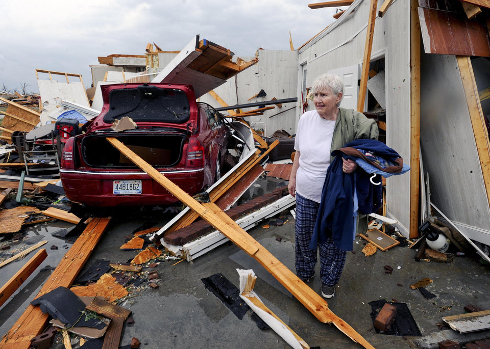 Photo - Amy Ledford stands by the remains of her house, Wednesday, April 27, 2011 near Athens, Ala. A wave of severe storms laced with tornadoes strafed the South on Wednesday, killing at least 16 people around the region and splintering buildings across swaths of an Alabama university town. (AP Photo/The Decatur Daily, Gary Cosby Jr.)