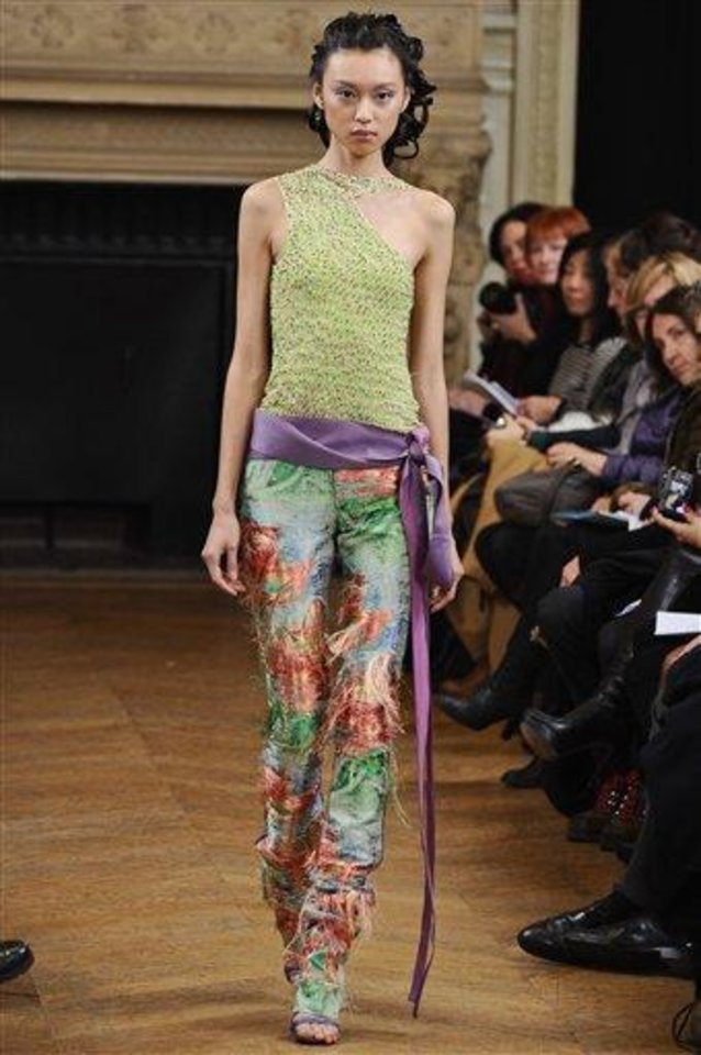 Photo - A model wears a creation by fashion designer Maurizio Galante as part of his Spring/Summer 2013 Haute Couture fashion collection, presented in Paris, Monday, Jan. 21, 2013. (AP Photo/Zacharie Scheurer)