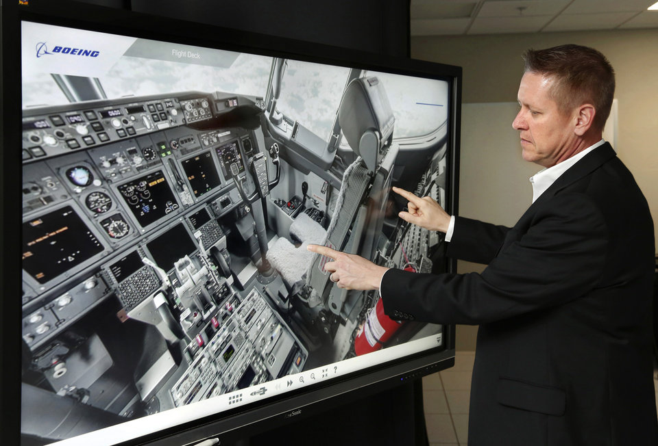 Photo -  Jeff Guziar, the lead at Boeing's Virtual Operations and Integrated Customer Experience Center, gives a virtual tour of a Boeing C-40A, a variant of the 737 aircraft.