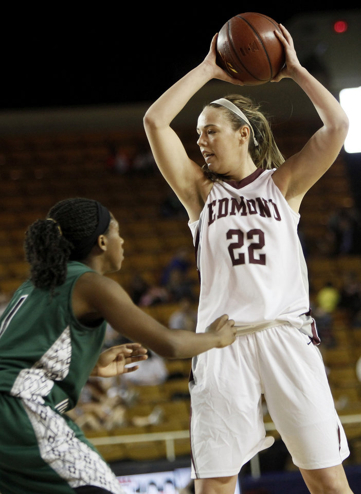 Edmond Memorial\'s Alie Decker (22) keeps the ball away from Edmond Santa Fe\'s Jasmine Hinton (1) during the Class 6A girls high school basketball state tournament championship game between Edmond Santa Fe and Edmond Memorial at the Mabee Center in Tulsa, Okla., Saturday, March 10, 2012. Santa Fe won, 44-41. Photo by Nate Billings, The Oklahoman