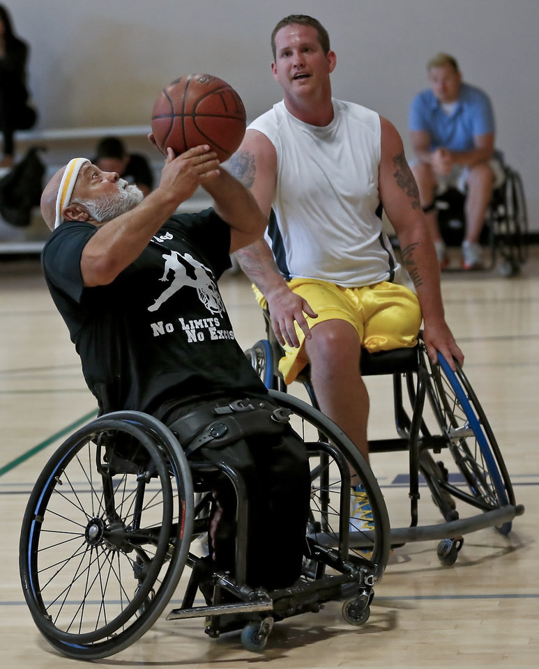 Larry Salyer, left, puts up a shot in front Brian Wofford during the Endeavor Games at the University of Central Oklahoma on Friday, June 7, 2013 in Edmond, Okla.  Photo by Chris Landsberger, The Oklahoman