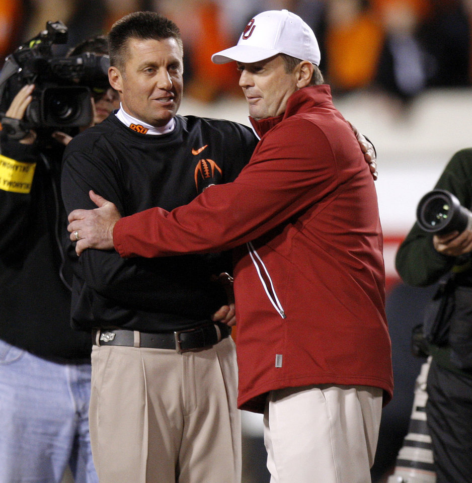 Oklahoma State coach Mike Gundy and Oklahoma coach Bob Stoops meet before the Bedlam college football game between the Oklahoma State University Cowboys (OSU) and the University of Oklahoma Sooners (OU) at Boone Pickens Stadium in Stillwater, Okla., Saturday, Dec. 3, 2011. Photo by Bryan Terry, The Oklahoman