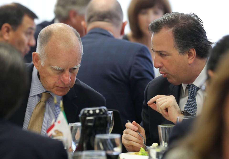 Photo - Gov. Jerry Brown, left,  and Mexican Secretary of Foreign Affairs Jose Antonio Meade Kuribrena talk during a luncheon held by the California Chamber of Commerce  Wednesday, July 23, 2014, in Sacramento, Calif.  Brown and Meade discussed Brown's upcoming visit to Mexico. (AP Photo/Rich Pedroncelli)