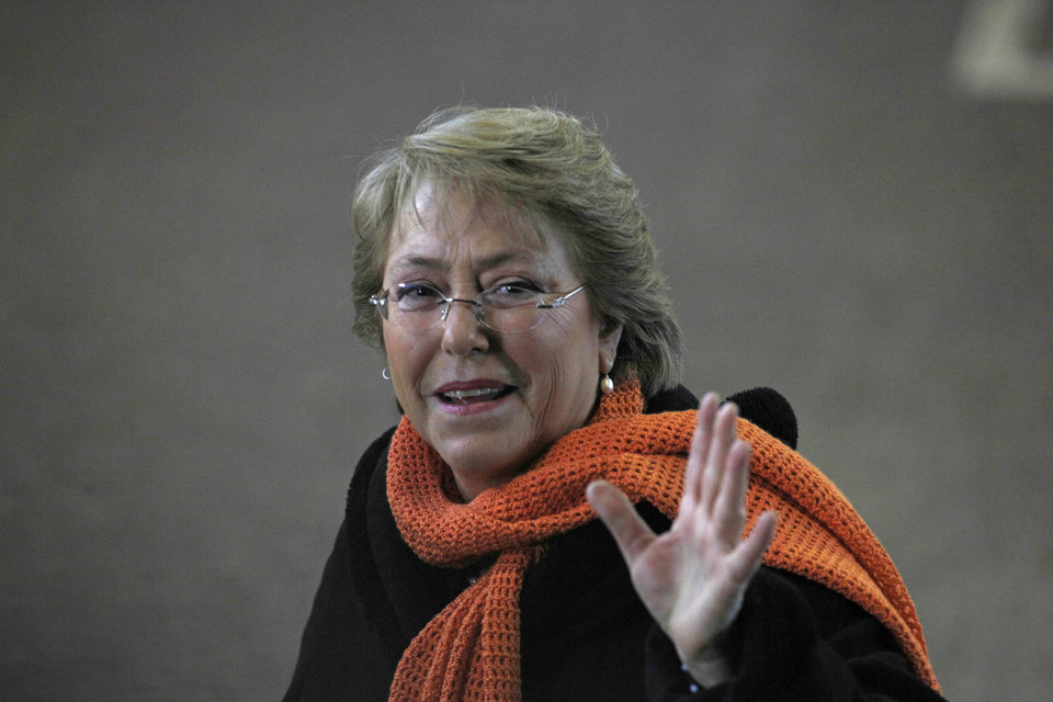 Photo - Former President Michelle Bachelet greets photographers during presidential primaries in Santiago, Chile, Sunday June 30, 2013. Voters will pick a candidate from Chile's two grand coalitions, the New Majority on the left and the conservative Alliance for Chile on the right. The vote will decide who runs in the Nov. 17 presidential election. Bachelet is likely to win the New Majority slot. (AP Photo/Luis Hidalgo)
