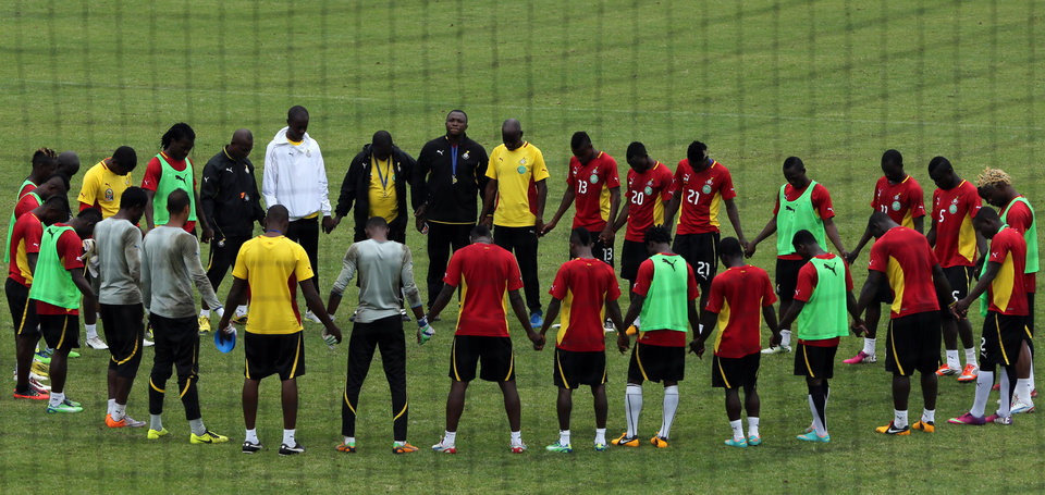 Photo - Ghana players form a circle at the end of their training at the team hotel in Nelspruit, South Africa, Tuesday Feb. 5, 2013. Ghana will play their African Cup of Nations semifinal soccer match against Burkina Faso on Wednesday. (AP Photo/Themba Hadebe)
