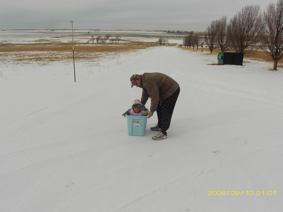 Brad and Kelsy Baker are sledding in El Reno down the driveway! Kelsy is having a great time!<br/><b>Community Photo By:</b> Michelle Baker<br/><b>Submitted By:</b> michelle, El Reno