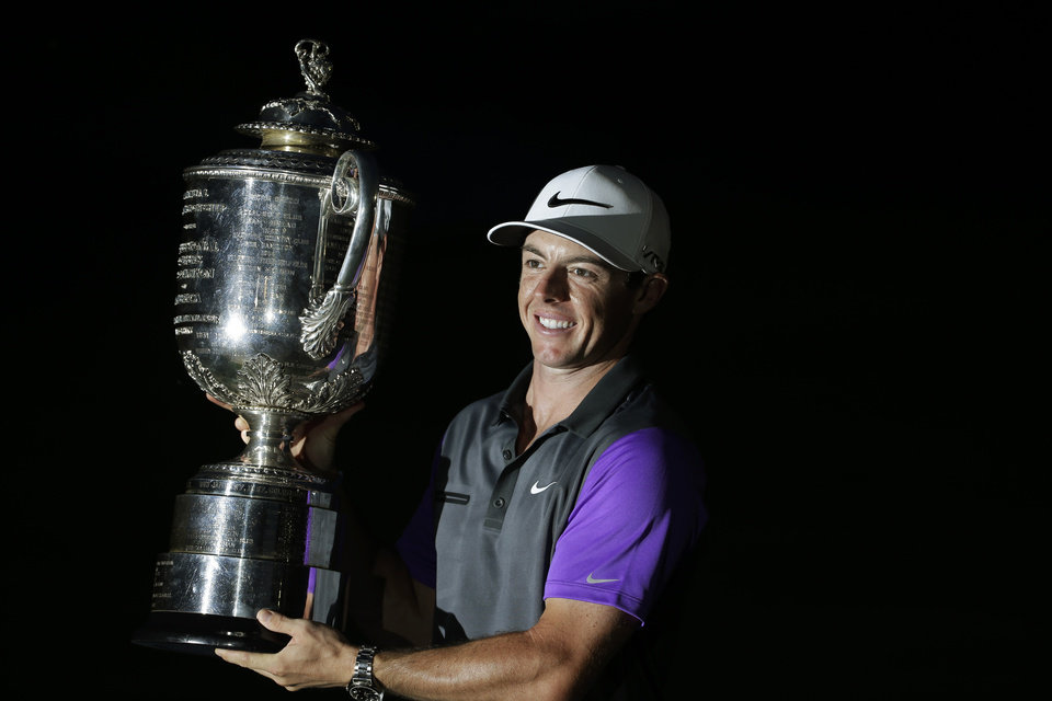 Photo - Rory McIlroy, of Northern Ireland, holds up the Wanamaker Trophy after winning the PGA Championship golf tournament at Valhalla Golf Club on Sunday, Aug. 10, 2014, in Louisville, Ky.  (AP Photo/David J. Phillip)