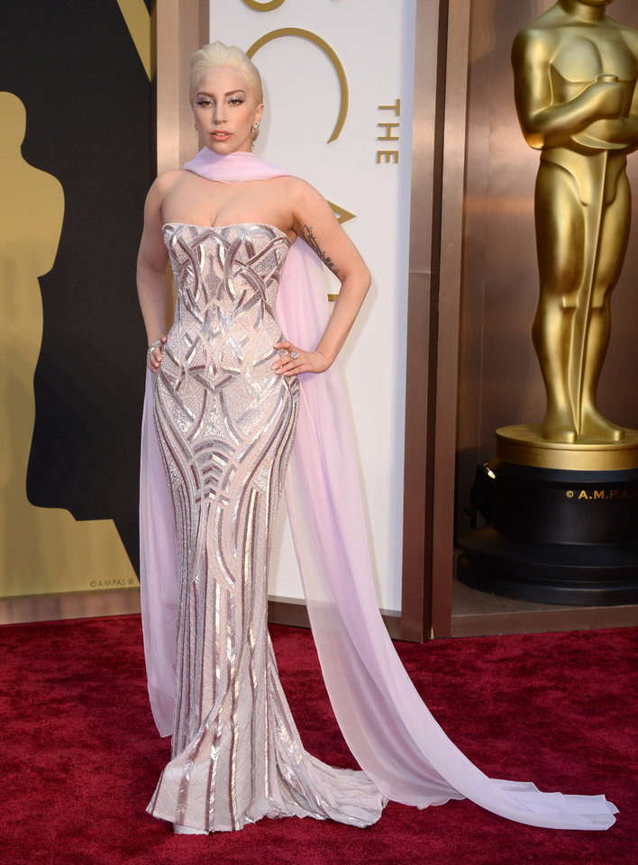 Photo - Lady Gaga arrives at the Oscars on Sunday, March 2, 2014, at the Dolby Theatre in Los Angeles.  (Photo by Jordan Strauss/Invision/AP)