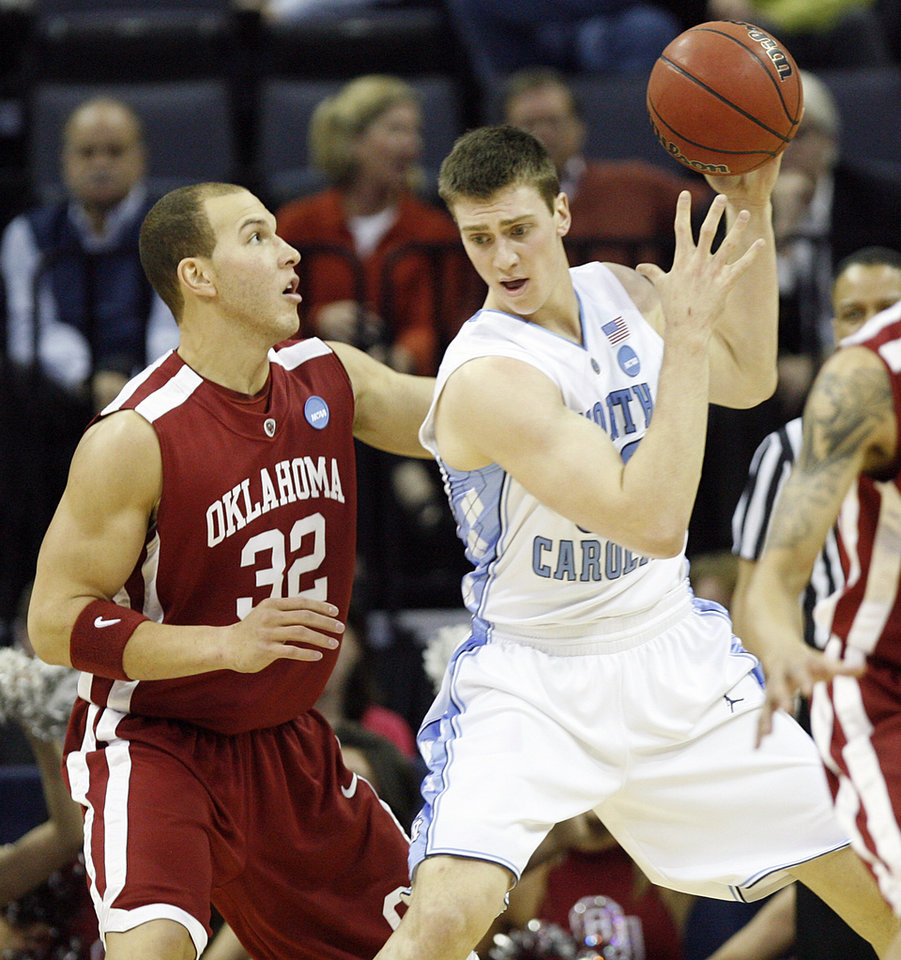 Photo - Oklahoma's Taylor Griffin (32) defends on North Carolina's Tyler Hansbrough (50) during the first half in the Elite Eight game of NCAA Men's Basketball Regional between the University of North Carolina and the University of Oklahoma at the FedEx Forum on Sunday, March 29, 2009, in Memphis, Tenn.