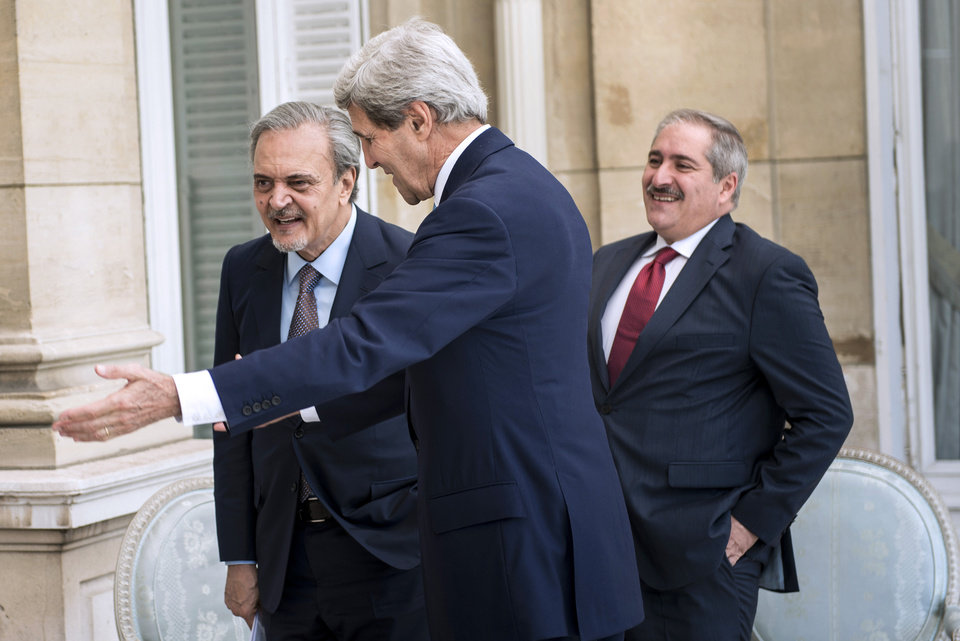 Photo - Jordanian Foreign Minister Nasser Judeh, right, US Secretary of State John Kerry, center, and Saudi Arabia's Foreign Minister Prince Saud al-Faisal walk to a meeting at the US Chief of Mission Residence in Paris, France. US Secretary of State John Kerry arrived in Paris on June 26, 2014 after stops in Baghdad, Arbil and Brussels to brief his Saudi, French and Israeli counterparts on his talks in Iraq and discuss the bloody three-year war in Syria. (AP Photo/Brendan Smialowski, pool)