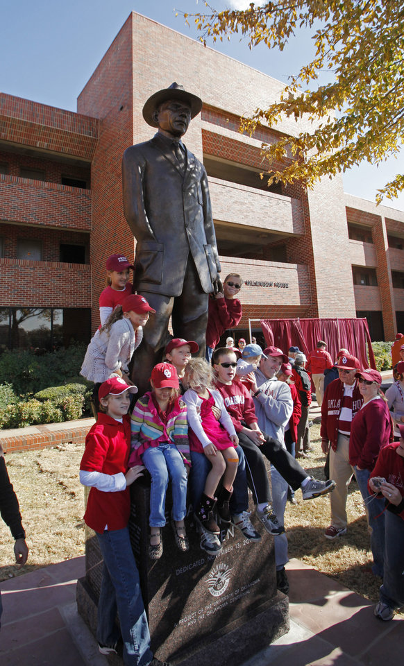Photo - Statues of 100 plus win head football coaches Benny Owen and Bud Wilkinson are unveiled before the college football game between the University of Oklahoma Sooners (OU) and the Texas Tech Red Raiders (TTU) across the street from the Gaylord Family Memorial Stadium on Saturday, Nov. 13, 2010, in Norman, Okla.  Photo by Steve Sisney, The Oklahoman