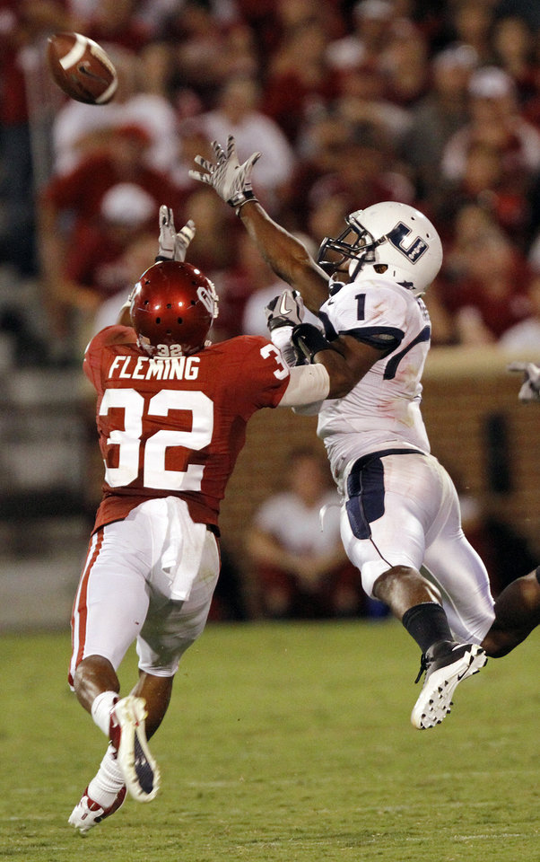 Photo - Oklahoma's Jamell Fleming (32) breaks up a pass for Utah State's Xavier Martin (1) during the second half of the college football game between the University of Oklahoma Sooners (OU) and Utah State University Aggies (USU) at the Gaylord Family-Oklahoma Memorial Stadium on Saturday, Sept. 4, 2010, in Norman, Okla.   Photo by Chris Landsberger, The Oklahoman