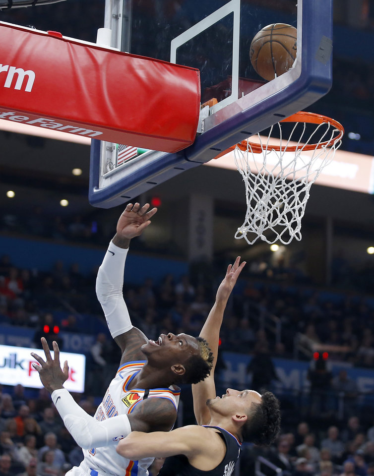Photo - Oklahoma City's Dennis Schroder (17) makes a basket beside LA's Landry Shamet (20) during an NBA basketball game between the Oklahoma City Thunder and the Los Angeles Clippers at Chesapeake Energy Arena in Oklahoma City, Tuesday, March 3, 2020. [Bryan Terry/The Oklahoman]