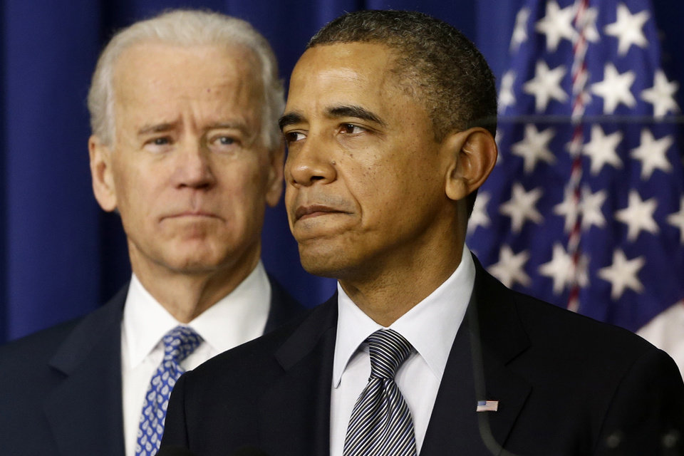 President Barack Obama, accompanied by Vice President  Joe Biden, talks about proposals to reduce gun violence, Wednesday, Jan. 16, 2013, in the South Court Auditorium at the White House in Washington. (AP Photo/Charles Dharapak) ORG XMIT: WHCD101