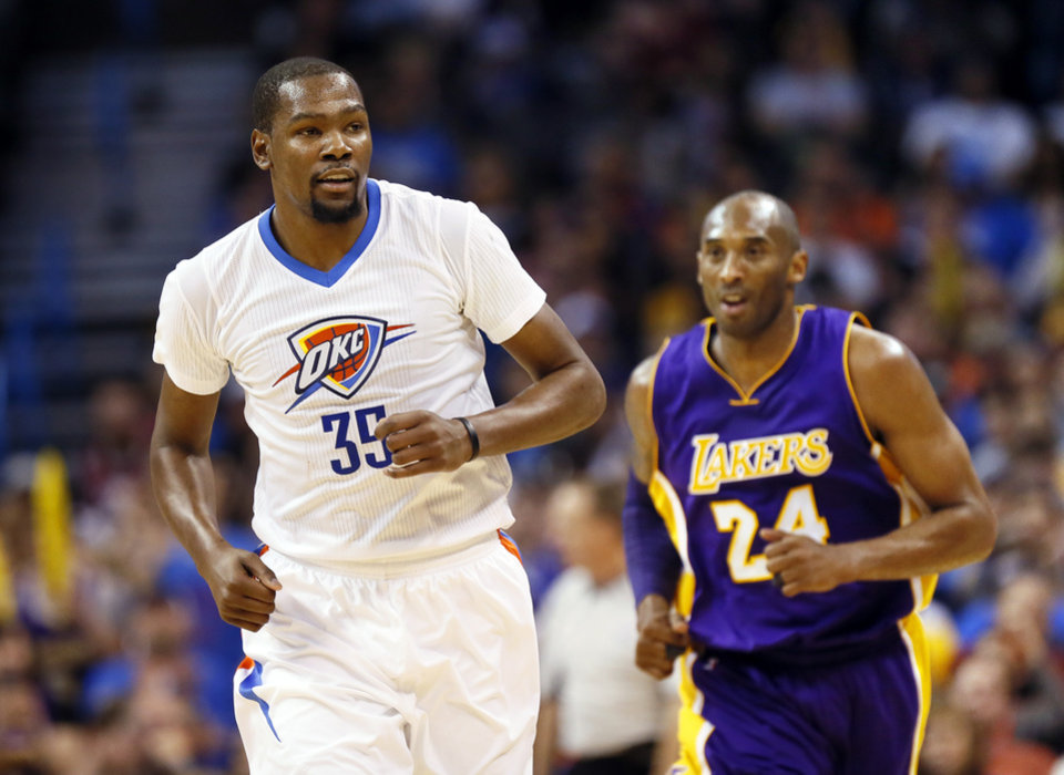 Photo - Oklahoma City's Kevin Durant (35) runs back on defense after hitting a shot against Los Angeles' Kobe Bryant (24) during an NBA basketball game between the Oklahoma City Thunder and the Los Angeles Lakers at Chesapeake Energy Arena in Oklahoma City, Monday, April 11, 2016. [Nate Billings/The Oklahoman]