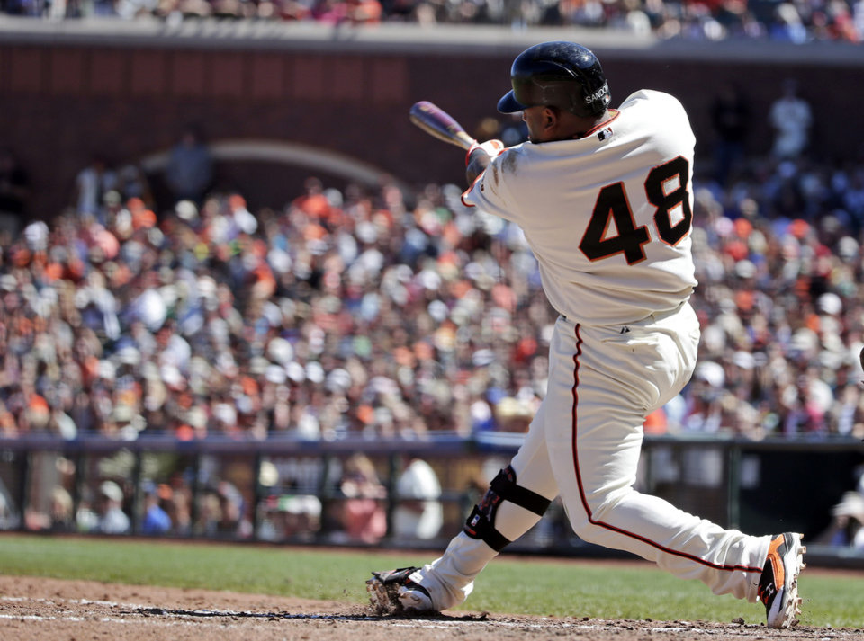 Photo - San Francisco Giants' Pablo Sandoval hits a two-run home run against the Milwaukee Brewers during the fifth inning of a baseball game on Sunday, Aug. 31, 2014, in San Francisco. (AP Photo/Marcio Jose Sanchez)