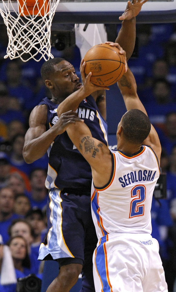 Photo - Memphis' Tony Allen (9) defends on Oklahoma City's Thabo Sefolosha (2) during game one of the Western Conference semifinals between the Memphis Grizzlies and the Oklahoma City Thunder in the NBA basketball playoffs at Oklahoma City Arena in Oklahoma City, Sunday, May 1, 2011. Photo by Chris Landsberger, The Oklahoman