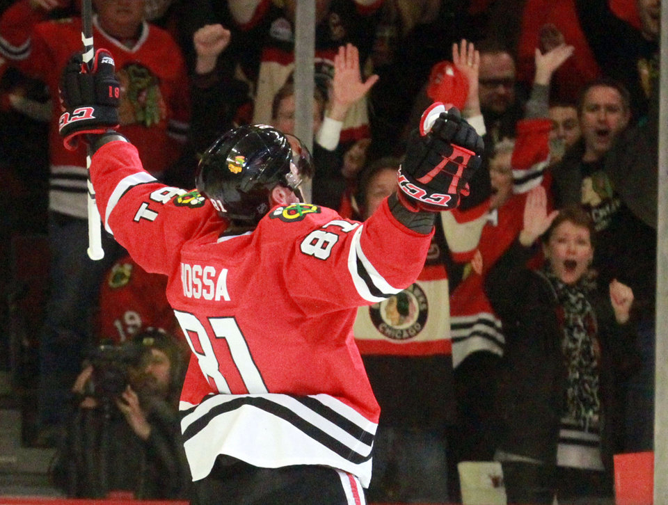 Photo - Chicago Blackhawks right wing Marian Hossa celebrates his second goal of the game as the Blackhawks defeated the Minnesota Wild 5-1 in Game 5 of an NHL hockey Stanley Cup first-round playoff series in Chicago, Thursday, May 9, 2013. (AP Photo/Daily Herald,  George LeClaire)