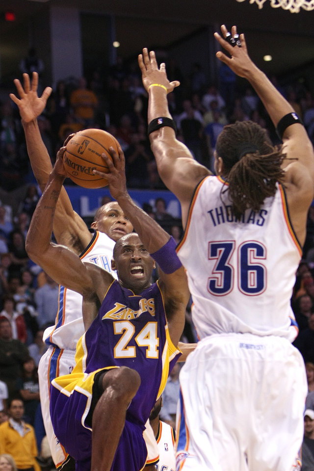 Photo - Oklahoma City Thunder center Etan Thomas and Russell Westbrook try to block the shot of Lakers guard Kobe Bryant during the Thunder - Lakers game November 3, 2009 in the Ford Center in Oklahoma City.  [Hugh Scott/The Oklahoman Archives]