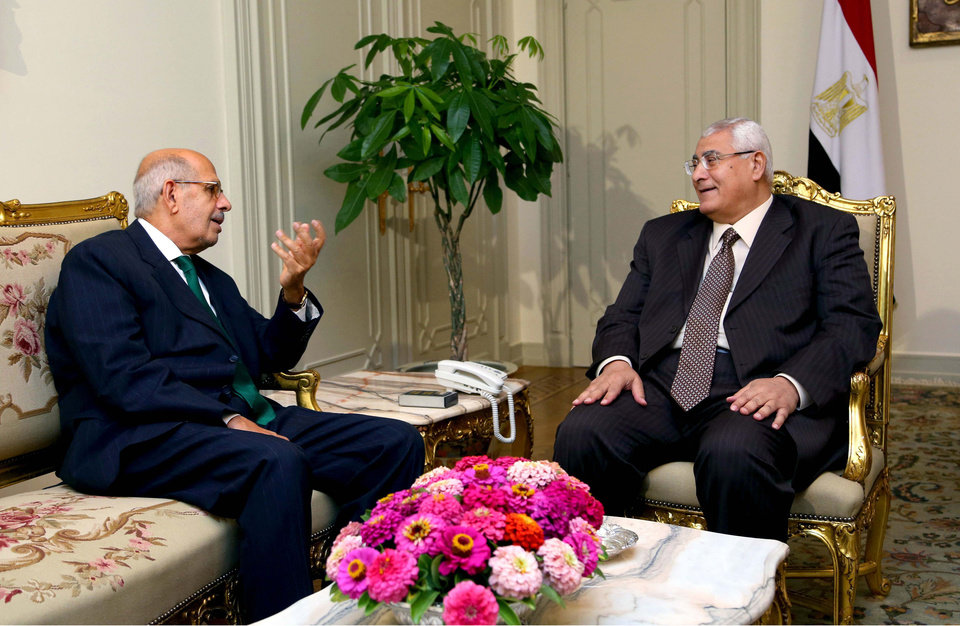 "Photo - FILE - In this Saturday, July 6, 2013 photo released by the office of the Egyptian Presidency, Mohamed Elbaradei, left, meeting with interim president Adly Mansour, right, at the presidential palace. Egypt's interim president has an economist as prime minister and pro-reform leader Mohamed ElBaradei as vice president, ending days of deadlock. The head of the military shows his resolve to push the political process ahead, warning factions that ""political maneuvering"" must not hold up the transition toward new elections to choose a replacement for the ousted Mohammed Morsi. Still, a youth movement behind the anti-Morsi uprising expresses its discontent over the transition. (AP Photo/Egyptian Presidency, File)"