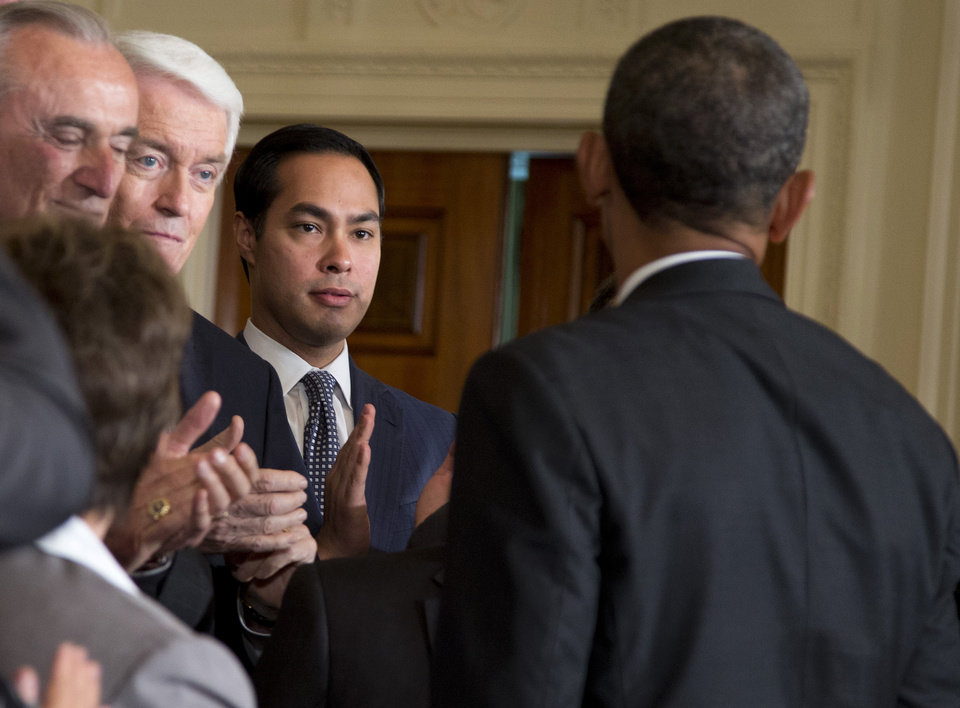 Photo - San Antonio, Texas Mayor Julian Castro, center, applauds President Barack Obama in the East Room of the White House in Washington, Tuesday, June 11, 2013, after the president spoke about immigration reform. From left are, Los Angeles Police Chief William Bratton, US Chamber of Commerce CEO Thomas Donohue and Castro.  (AP Photo/Evan Vucci)