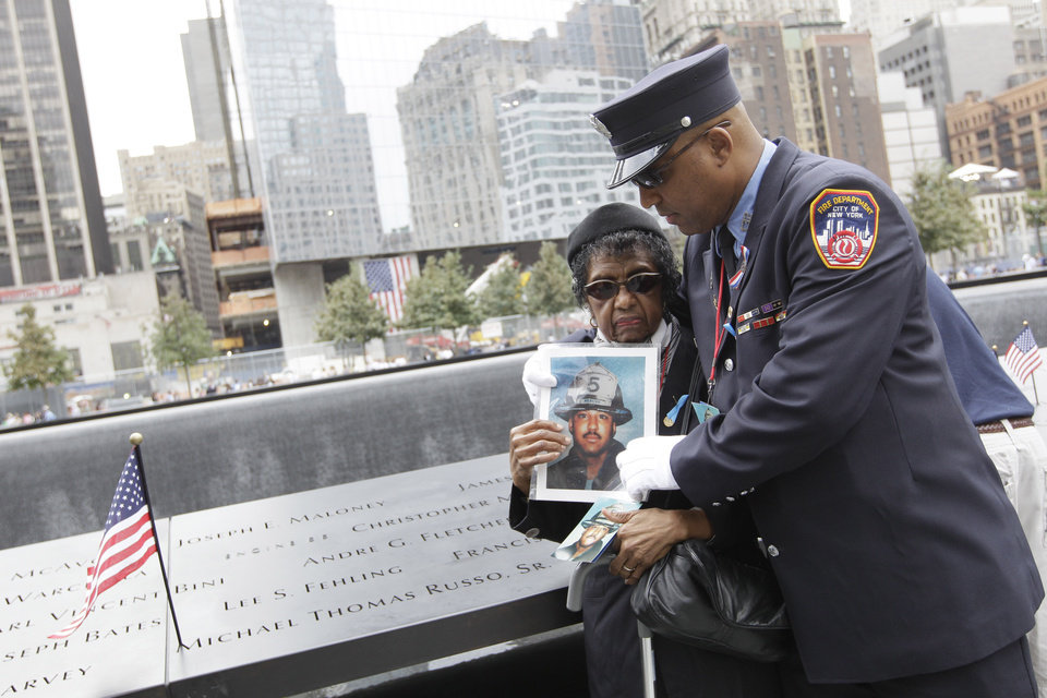 NewYork Firefighter Zachary Fletcher embraces his mother Monica Fletcher after finding his twin brother Andre G. Fletcher's name engraved at the south pool of the National September 11 Memorial during a ceremony marking the 10th anniversary of the attacks at World Trade Center, Sunday, Sept. 11, 2011 in New York.  (AP Photo/Mary Altaffer)