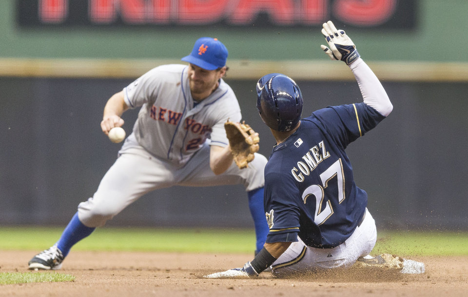 Photo - Milwaukee Brewers' Carlos Gomez steals second against New York Mets' as Daniel Murphy covers during the second inning of a baseball game Thursday, July 24, 2014, in Milwaukee. (AP Photo/Tom Lynn)