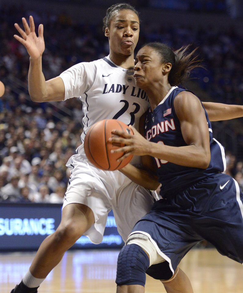 Photo - Connecticut's Brianna Banks, right, tries to elude Penn State's Ariel Edwards (23) during the first half of an NCAA college basketball game, Sunday, Nov. 17, 2013, in State College, Pa. (AP Photo/John Beale)