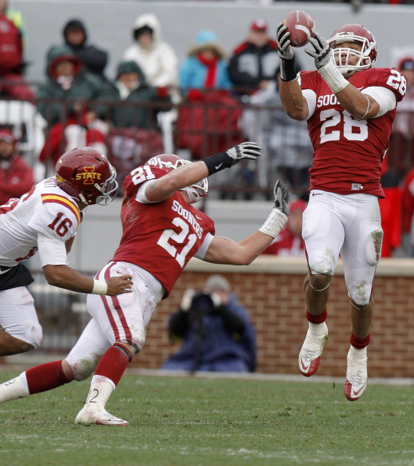 Oklahoma's Travis Lewis (28) intercepts a pass beside Tom Wort (21) and Iowa State's Jared Barnett (16) during a college football game between the University of Oklahoma Sooners (OU) and the Iowa State University Cyclones (ISU) at Gaylord Family-Oklahoma Memorial Stadium in Norman, Okla., Saturday, Nov. 26, 2011. Photo by Bryan Terry, The Oklahoman