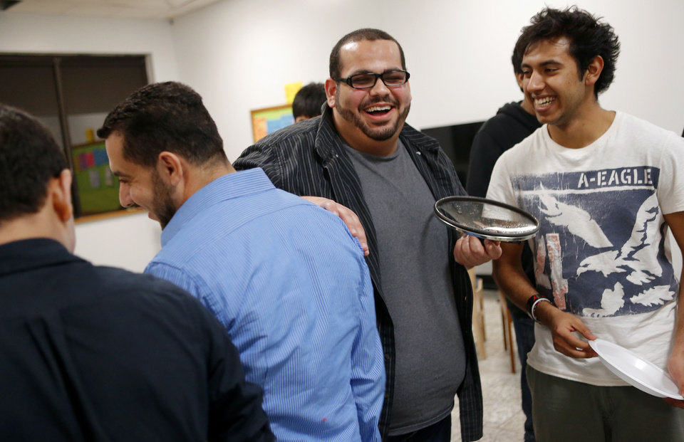 Photo - The Islamic Society of Greater Oklahoma City's new youth director Abdur-Rahman Taleb laughs with Rafeh Waheed, 17, during youth activities at the Mercy School complex, 14001 N Harvey. Photos by BRYAN TERRY, THE OKLAHOMAN