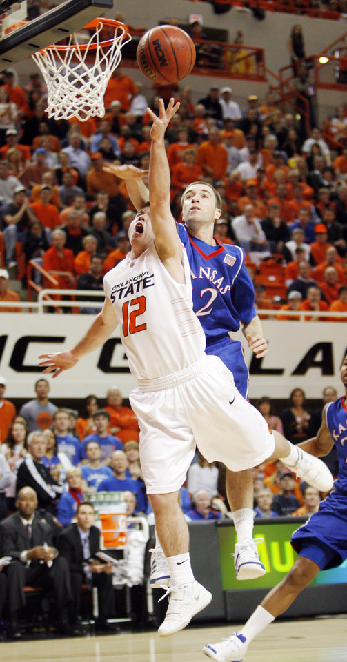 OSU's Keiton Page (12) is fouled by Brady Morningstar (12) of KU in the first half during the men's college basketball game between the University of Kansas (KU) and Oklahoma State University (OSU) at Gallagher-Iba Arena in Stillwater, Okla., Saturday, Feb. 27, 2010. Page made this basket and the foul shot. Photo by Nate Billings, The Oklahoman