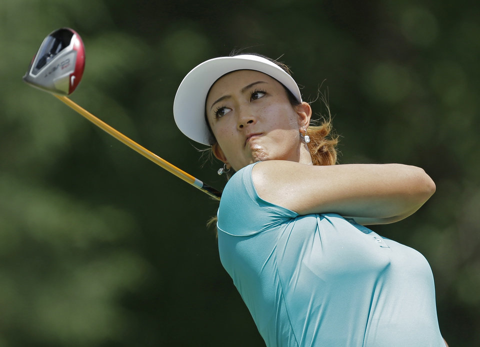 Photo - Michelle Wie watches her tee shot on the seventh hole during the final round of the U.S. Women's Open golf tournament in Pinehurst, N.C., Sunday, June 22, 2014. (AP Photo/Bob Leverone)