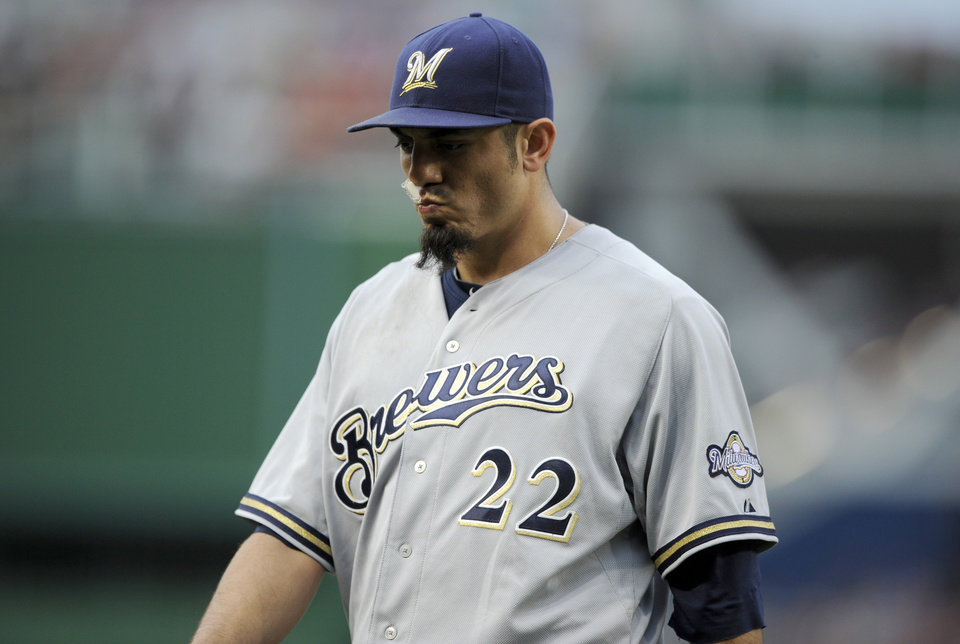 Photo - Milwaukee Brewers starting pitcher Matt Garza heads to the dugout after he was pulled from the baseball game against the Washington Nationals during the first inning Saturday, July 19, 2014, in Washington. (AP Photo/Nick Wass)