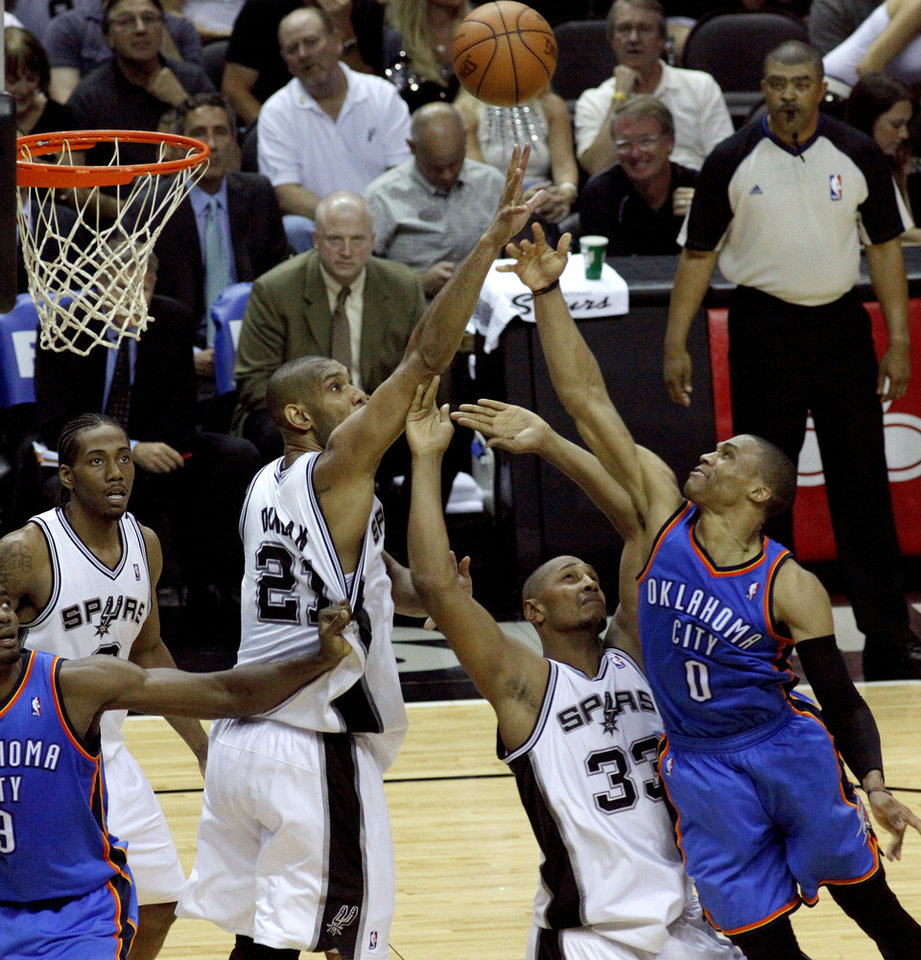 Oklahoma City's Russell Westbrook (0) puts up a shot over San Antonio's Boris Diaw (33) and Tim Duncan (21) during Game 2 of the Western Conference Finals between the Oklahoma City Thunder and the San Antonio Spurs in the NBA playoffs at the AT&T Center in San Antonio, Texas, Tuesday, May 29, 2012. Oklahoma City lost 120-111. Photo by Bryan Terry, The Oklahoman