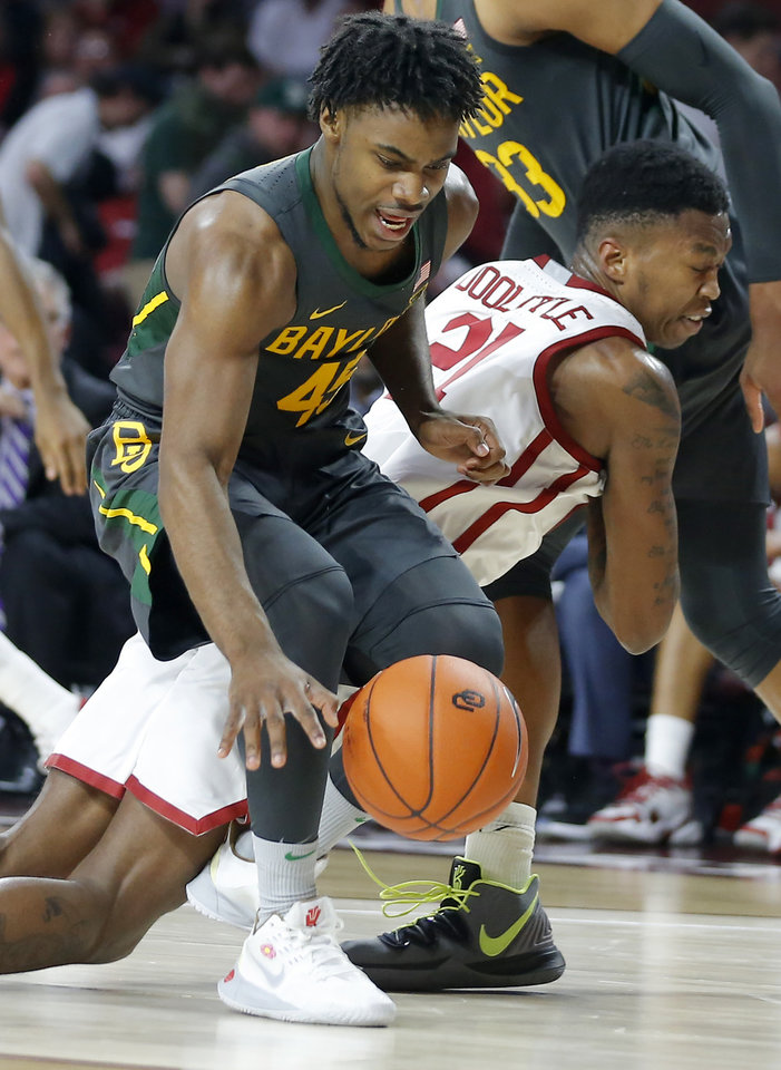 Photo - Baylor's Davion Mitchell (45) gathers the ball in front of Oklahoma's Kristian Doolittle (21) during a men's NCAA basketball game between the University of Oklahoma Sooners (OU) and the Baylor Bears at the Lloyd Noble Center in Norman, Okla., Tuesday, Feb. 18, 2020. Baylor won 65-54. [Bryan Terry/The Oklahoman]
