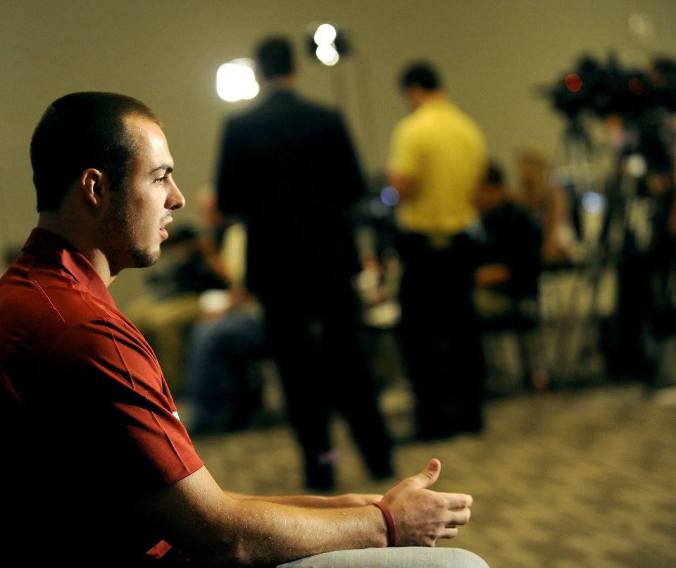 Oklahoma quarterback Landry Jones pauses between questions during NCAA college football Big 12 Media Days, Tuesday, July 26, 2011, in Dallas. (AP Photo/Matt Strasen)