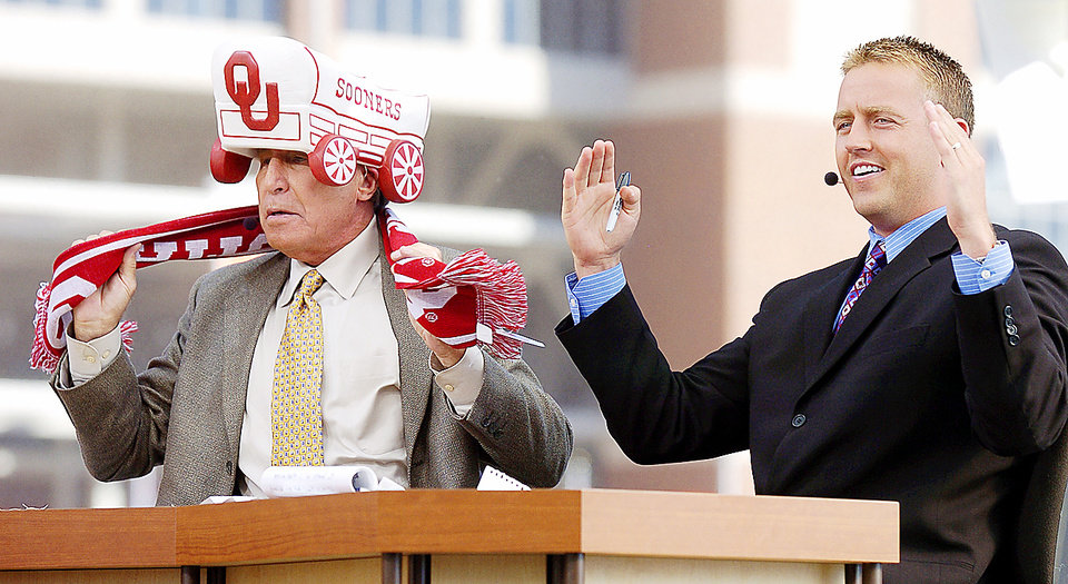 ESPN College GameDay�s Lee Corso, left, puts on an OU hat and scarf as Kirk Herbstreit spells OU with his arms. The GameDay crew brought bad luck for the Sooners against Missouri last season, but OU is 17-8 overall in games visited by GameDay. Photo By Nate Billings, The Oklahoman Archive