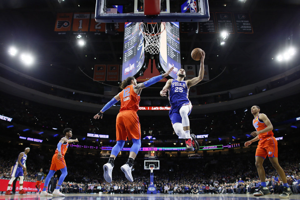 Photo - Philadelphia 76ers' Ben Simmons (25) goes up for a shot against Oklahoma City Thunder's Steven Adams (12) during the first half of an NBA basketball game, Monday, Jan. 6, 2020, in Philadelphia. (AP Photo/Matt Slocum)
