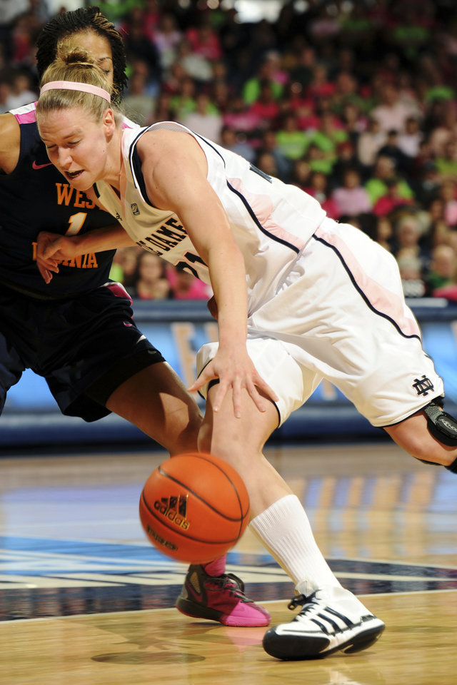 Notre Dame guard Natalie Novosel drives to the basket as West Virginia guard Christal Caldwell, rear, defends during the first half of an NCAA college basketball game, Sunday, Feb. 12, 2012, in South Bend, Ind. (AP Photo/Joe Raymond)