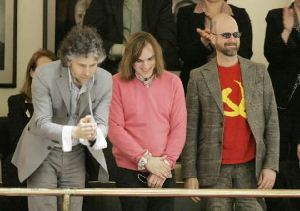 "Flaming Lips band members Wayne Coyne, Kliph Scurlock and Michael Ivins in March 2, 2009. Today the Oklahoma House rejected a resolution to name ""Do You Realize??"" as the state's official rock song because band member, Michael Ivins wore a T-shirt bearing a symbol associated with the Communist Party while at the state Capitol last month. BY STEVE GOOCH"