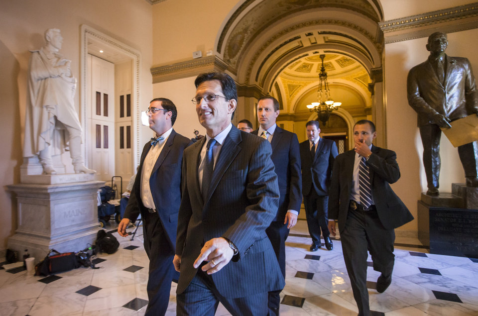 Photo - House Majority Leader Eric Cantor, R-Va., smiles as he leaves the floor of the House of Representatives at the Capitol in Washington, Friday, Sept. 20, 2013. The GOP-controlled House passed a bill that would prevent a government shutdown while crippling the health care law that was the signature accomplishment of President Barack Obama's first term,  (AP Photo/J. Scott Applewhite)