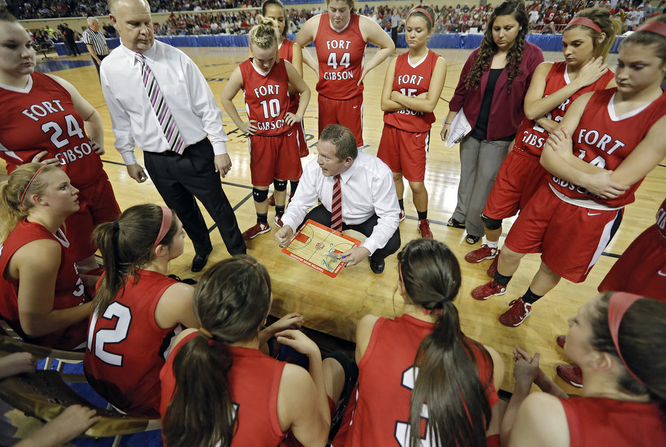 Fort Gibson coach Jerry Walker talks to his team in a timeout during the state high school basketball tournament Class 4A girls championship game between Fort Gibson High School and Mount St. Mary High School at the State Fair Arena on Saturday, March 9, 2013, in Oklahoma City, Okla. Photo by Chris Landsberger, The Oklahoman