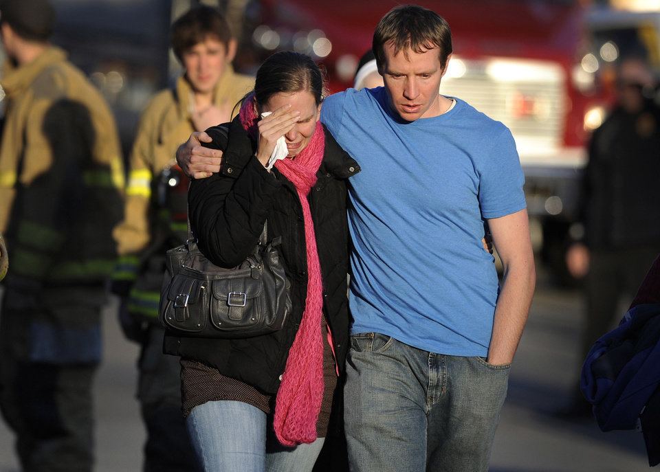 FILE - In this Dec. 14, 2012 file photo, Alissa Parker, left, and her husband, Robbie Parker,  leave the firehouse staging after receiving word that their six-year-old daughter Emilie was one of the 20 children killed in the Sandy Hook School shooting in Newtown, Conn.  Alissa Parker told �CBS This Morning� in an interview that aired Thursday, March 21, 2013, that she wanted to meet with Adam Lanza's father, Peter Lanza, to tell him �something� she needed to get out of her system. It's not clear what that something was. CBS planned to show the rest of the interview with Alissa and Robbie Parker on Friday morning revealing more details about their meeting with Peter Lanza.   (AP Photo/Jessica Hill)