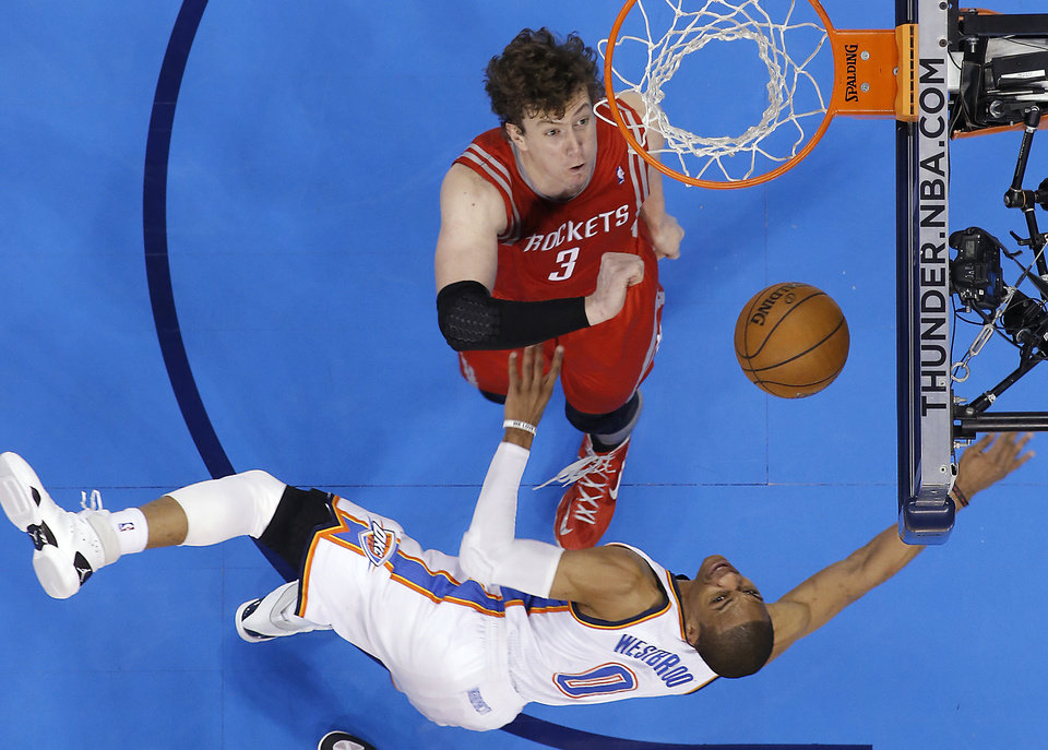 Oklahoma City\'s Russell Westbrook (0) puts up a shot against Houston\'s Omer Asik (3) during Game 2 in the first round of the NBA playoffs between the Oklahoma City Thunder and the Houston Rockets at Chesapeake Energy Arena in Oklahoma City, Wednesday, April 24, 2013. Photo by Chris Landsberger, The Oklahoman